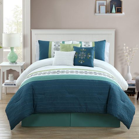 sarina comforter setthis elegant set with shams and decorative pillows features beautiful embroidery with pops of color to create