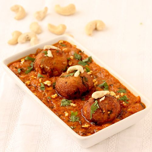 Paneer Kofta Curry - Easy Step by Step Recipe  Either served kofta alone with tomato ketch up or make the gravy. Deep fried paneer kofta stuffed with dry fruits and cooked in punjabi style masala gravy.Perfect curry to serve in lunch or dinner with butter naan, kulcha or tandoori roti, lassi and papad.
