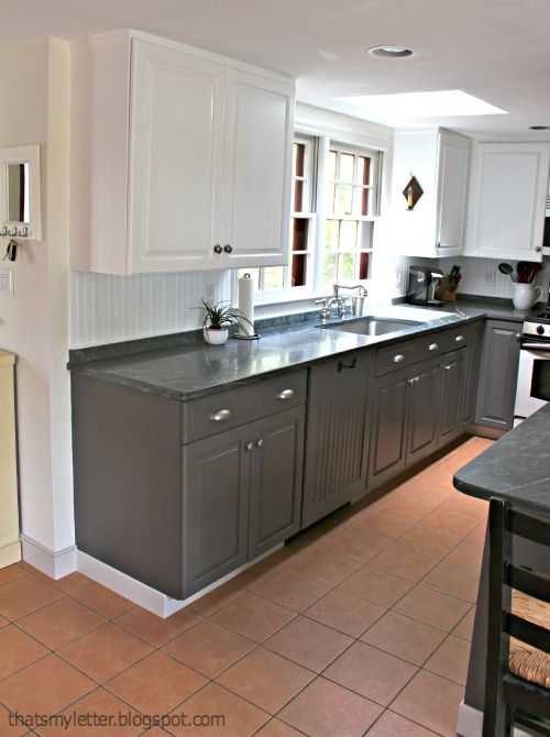 Benjamin Moore Simply White and Benjamin Moore Iron Mountain gray and white two toned kitchen cabinets. Love the white upper cabinets and gray lower cabinets | Involving Color Paint Color Blog