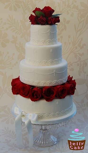 Tier Wedding Cake Tumbling Flowers And Leaves