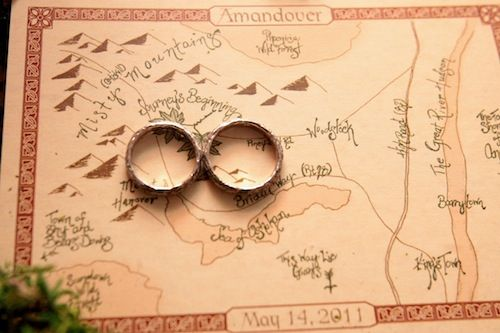 WOW. At an LotR themed wedding, maps in the style of JRR Tolkien. This is beyond gorgeous.