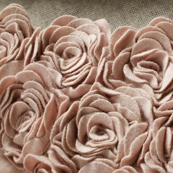 The intricate, appliquéd roses on our Rosy Chic Rug will give a touch of delicate elegance to any room in your home.