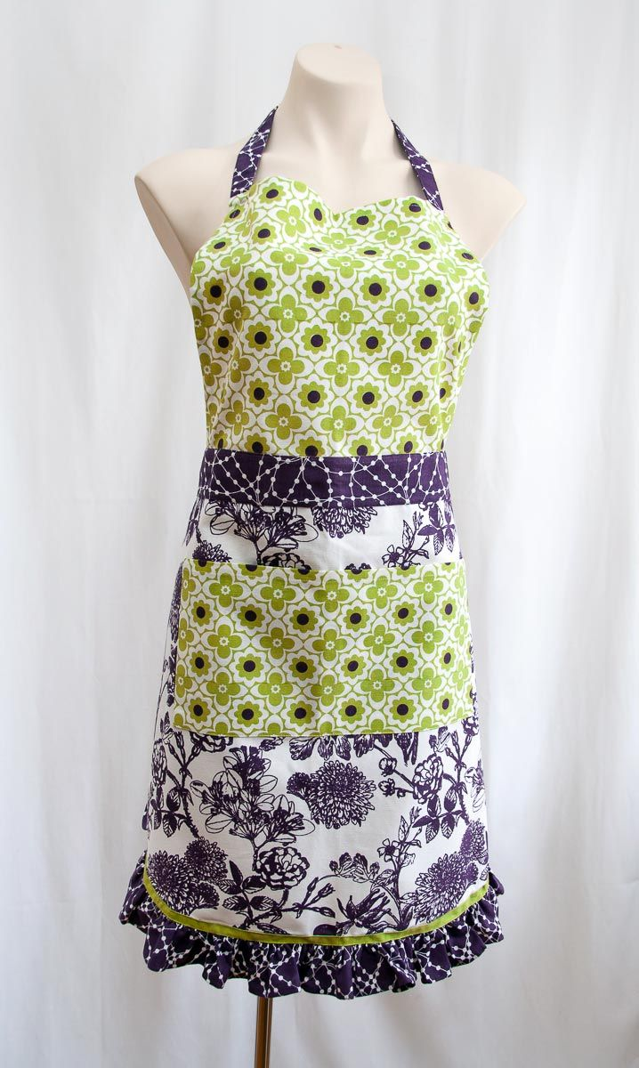 Every time I cook dinner or bake a cake I put on an apron to protect my clothes, so why not wear a cute retro designer apron! This is a really lovely design in fresh lime green, violet purple and white with garden botanicals and a frill around the bottom.  Buy this for yourself or give this as a gift to a friend who loves to cook. This is a unique gift for women. The size is approximately 70 x 85cm and this is a quality cotton fabric. Available from Gorgeous Creatures.