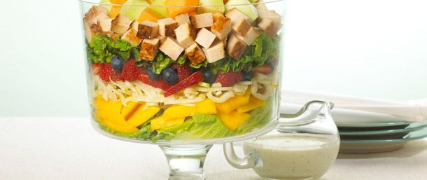 The healthy virtues of this salad are visible through the glass bowl where layers of color and texture are accented by a slightly sweet dressing and the homemade taste of slow-roasted chicken breast.