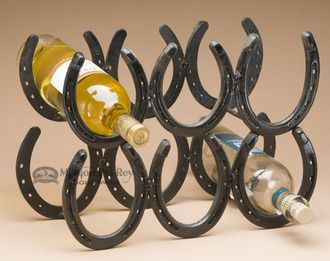 This rustic western style horseshoe six bottle wine rack is a perfect addition to any western, southwestern or rustic home and cabin. Created with real horseshoes with a black finish, this wine rack h