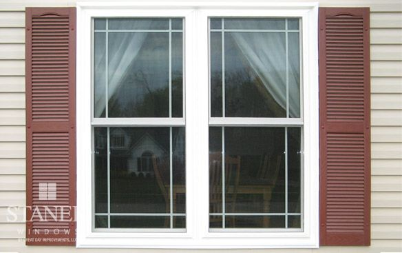 White, double-hung windows with modified single prairie metal grids. #replacementwindows #doublehungwindows