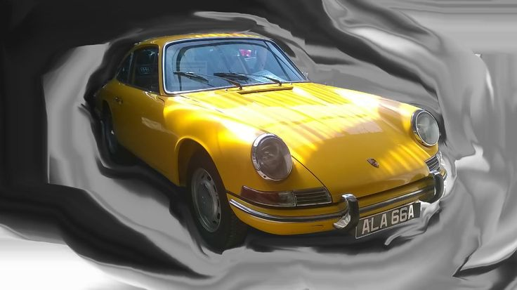 Taken whilst at a classic car auction in Kings Lynn. I am not a big fan of cars but I just got taken with what was an enjoyable day out. I have smudged the backgrounds to highlight the car.