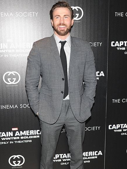 Looking dapper in a gray suit and coordinating tie, Chris Evans – who's not quitting acting – promotes his Captain America: The Winter Soldier at Cinema Society and Gucci Guilty screening at the Tribeca Grand Hotel in N.Y.C.   http://www.people.com/people/gallery/0,,20801819,00.html