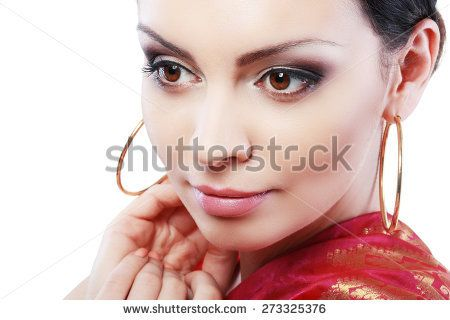 Pretty Indian girl portrait looking at the camera face close up