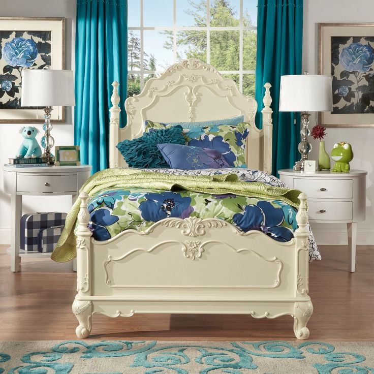 This kids' furniture set features Victorian styling with floral motif hardware, ecru painted finish and traditional carving details that create the feeling of a princess.