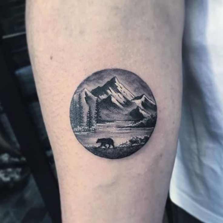 Landscape circle tattoo on the right inner forearm. Tattoo artist: Eva krbdk