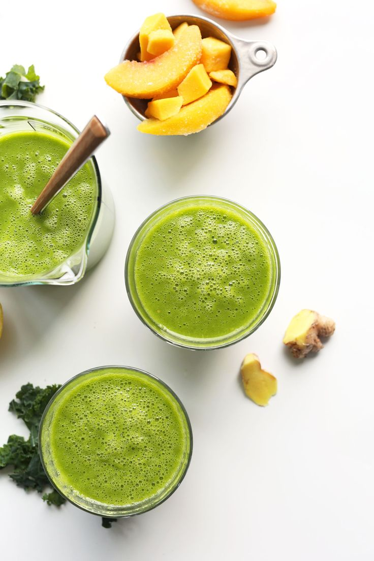 5-ingredient green smoothie inspired by Jamba Juice! Tart and sweet thanks to kale, lemon, ginger, peaches and mango!