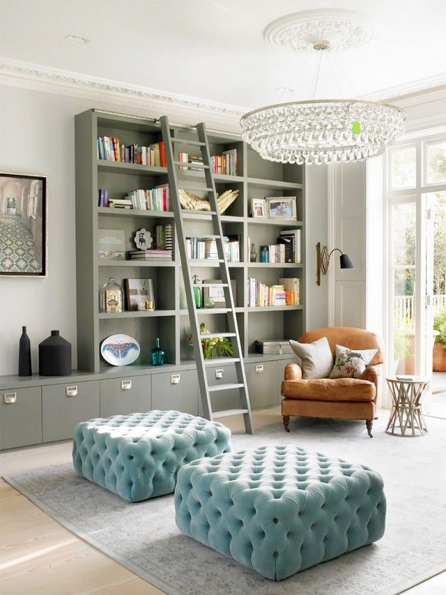 Reading nook located next to a window with the mix of a modern sconce with a