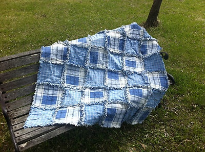 THIS RAG QUILT IS MADE FROM RECYCLED MATERIAL. I BUY GENTLEY USED DENIM, SHIRTS AND SHEETS, AND LOVINGLY RESEW THEM INTO RAG QUILTS.    IT IS 42 X 42 INCHES   $74.99