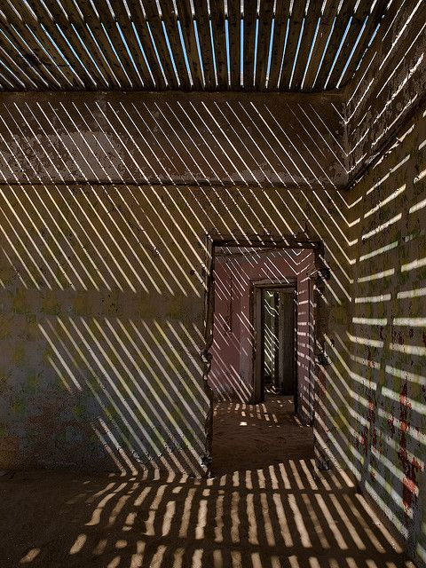 oxane:    Behind Bars by * Daniel *  Kolmanskop, Luderitz - Namibia. You can save a building only if the roof stays on, in this case I was glad nature had done its thing