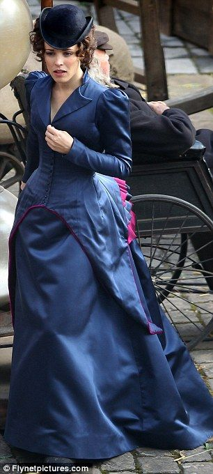 "From the ""Sherlock Holmes"" movie -- Rachel started the day in a luxurious velvet coat, before revealing her corseted dress"
