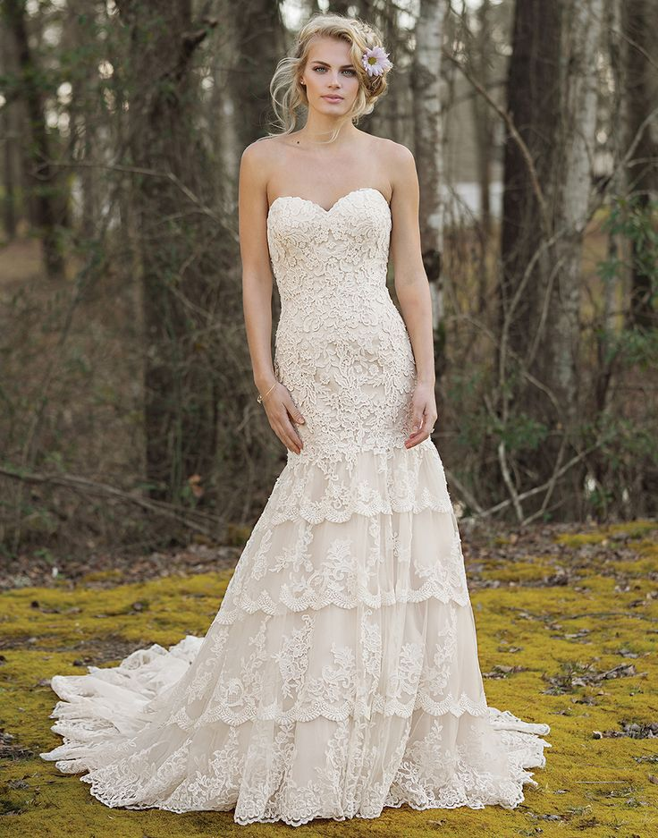 The unexpected monarch length train adds vigor to this fit and flare gown with a sweetheart neckline, allover lace design, and tiered lace trimmed skirt. Desire a train that is slightly shorter in length? This style is available with an 80 inch train as style 6465T80. https://www.lillianwest.com/lillian_west/6465