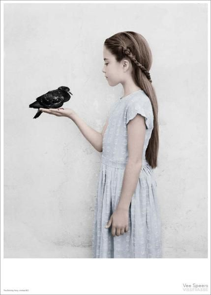 Vee Speersposter - girl with bird perched in her hand - ViSSEVASSE International