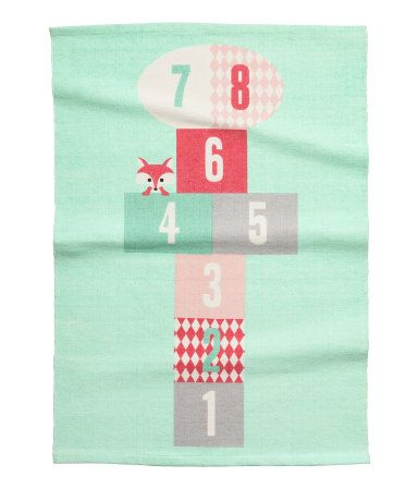 Mint green. Rectangular cotton rug with a printed hopscotch motif at front and non-slip backing.