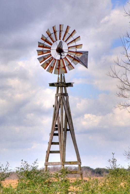 this old windmill stands beside a county road on the west side of the ...