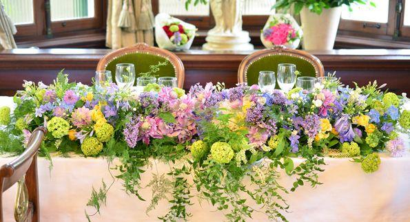 ナチュラルでエレガントな装花(パープル、ヴァイオレット、差し色イエロー) の画像|Garland