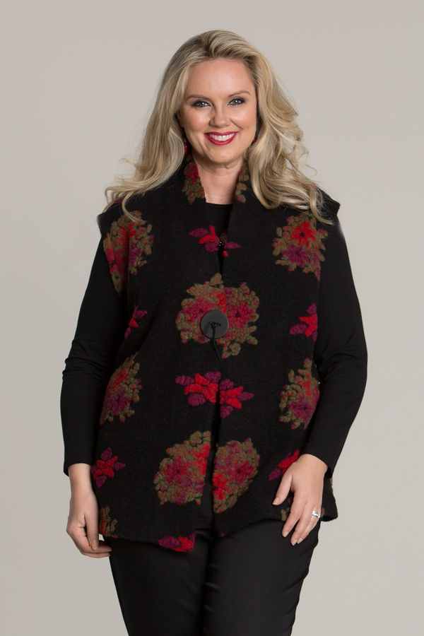 6614 One Button Vest Fob - Take yourself to a beautiful country cottage with this one button vest with a gorgeous floral design. Wear with a long sleeve Warm Handle Basic Top in black for the complete look. Features one large black button to close, V-neck, sleeveless-design and will sit just on the hips.