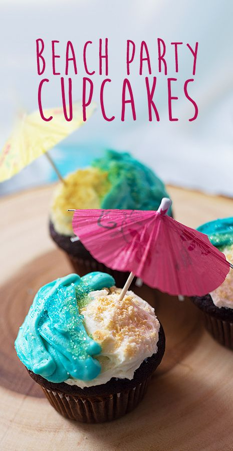 Beautiful, beach party cupcakes covered in blue buttercream and graham crumbs on top of the BEST chocolate cake. Perfect for a Tiki Party.