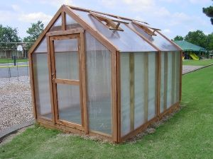Charming, Functional, and Sturdy : Charlotte Country Day School's 8'x12'Greenhouse - Microfarm Organic Gardens Blog - Microfarm Organic Gardens