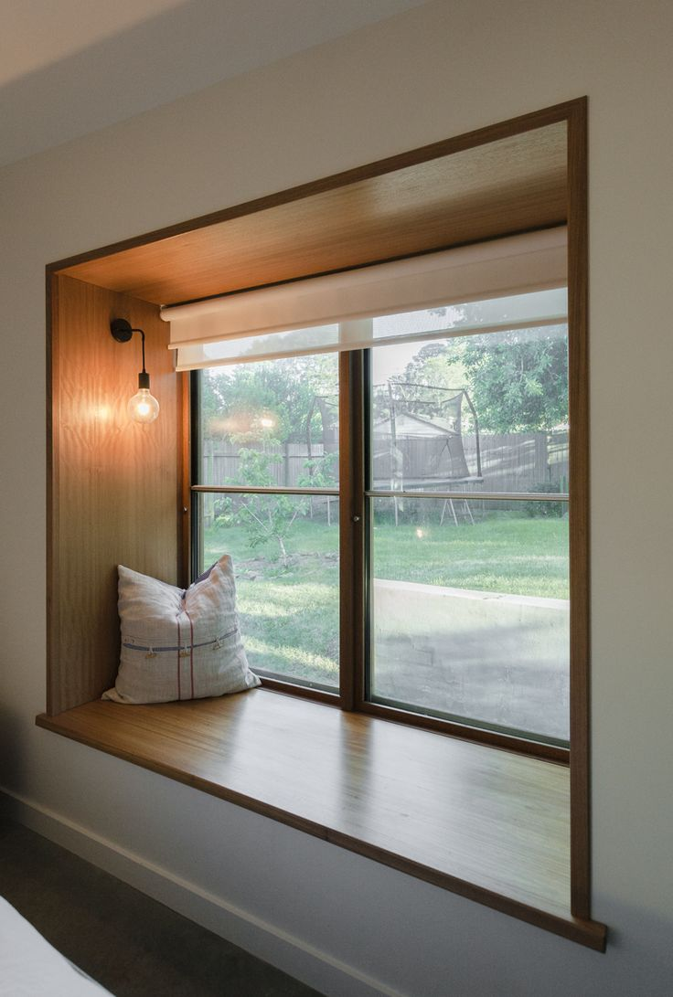 Blackbutt timber window seat and sashless window by Against the Grain Windows & Doors - the perfect place to read that novel and soak up the rays!