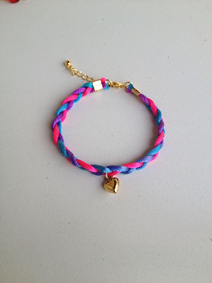 Braided bracelet with heart pendant