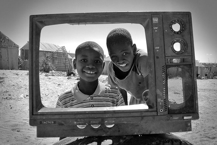 """Trashfighter, 2009 'During my research travel through western Africa on the topic of waste and recycling, I focused on children at dump sites. Through my series """"Trashfighters"""", I wanted to show the living realities of these people, fighting on the waste for their everyday survival'"""
