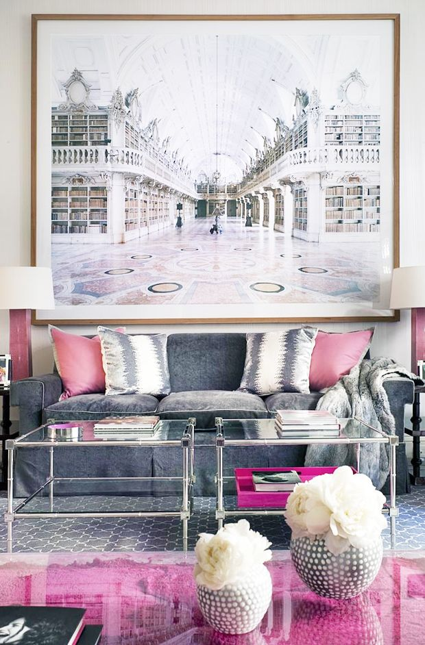 Doesn't this custom framed art hanging over the sofa act as a room extension?!? Pretty cool effect!