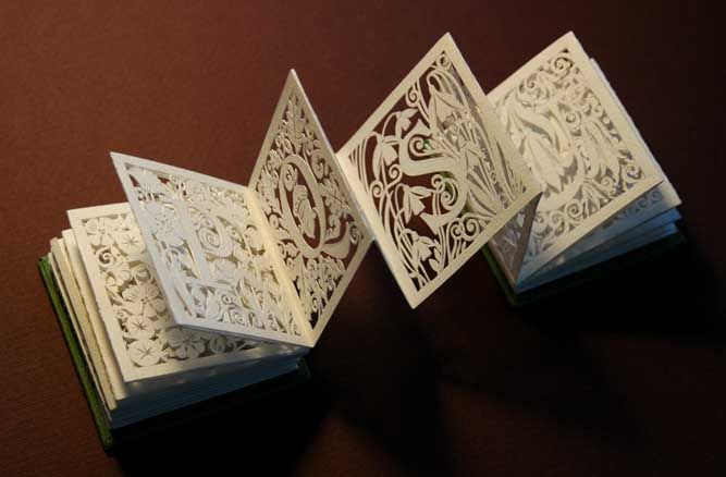 Paper art sculptures by white paper press--type flip book--beautiful!