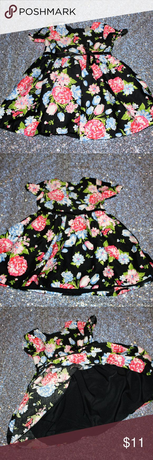 Carter's Flower Dress Size 12M This dress is lined. The glitter ribbon belt is a twisted and will need to be straightened and retied  *This item has been worn and will have signs of wear such as very slight fading. It is in very good used condition. Carter's Dresses Formal