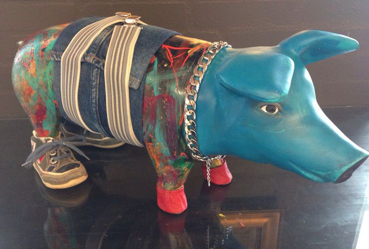 A pig in blue and canvas