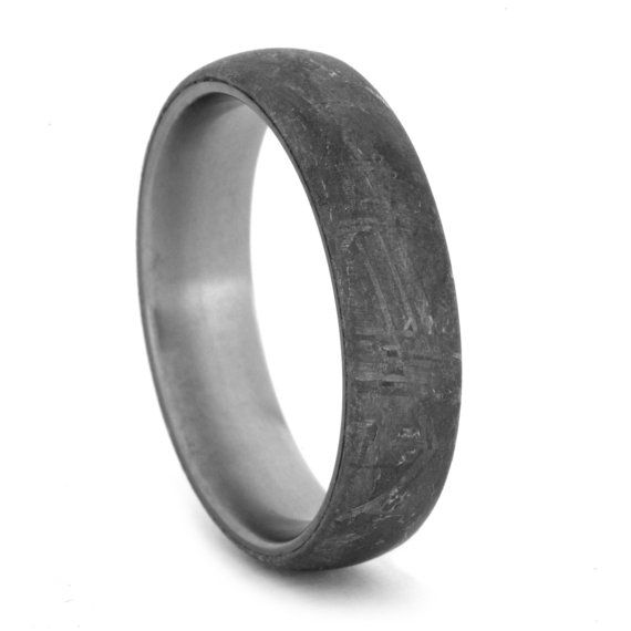 This is a genuine rare/scarce Gibeon Meteorite ring over a titanium band. The crystalline grain structure is totally unique and called