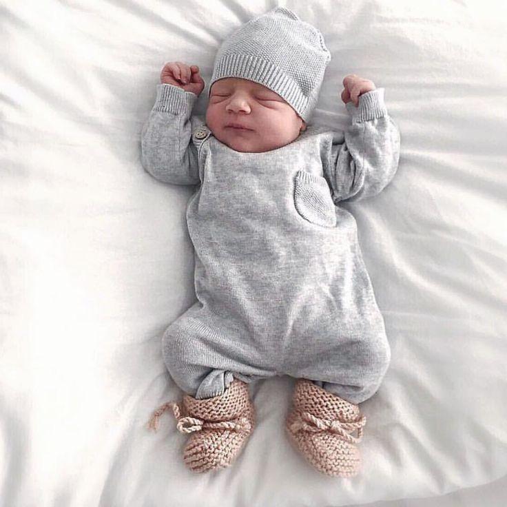 Precious sleeping newborn with knitted baby socks
