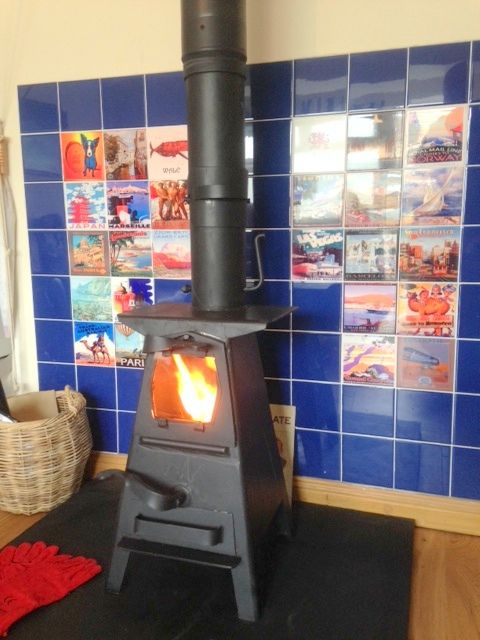 Thank you to Lindsey for sending in this great pic of her Dowling Firebug with the cutest of hotplates, installed and roaring! I love the tiles, oh, and the stove of course!