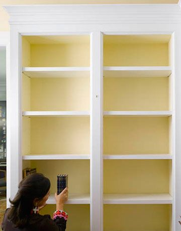 Empty your shelves. Back them with colored paper, or paint the backs a contrasting color. This will help make the objects pop. Annie Schlechter  - HouseBeautiful.com