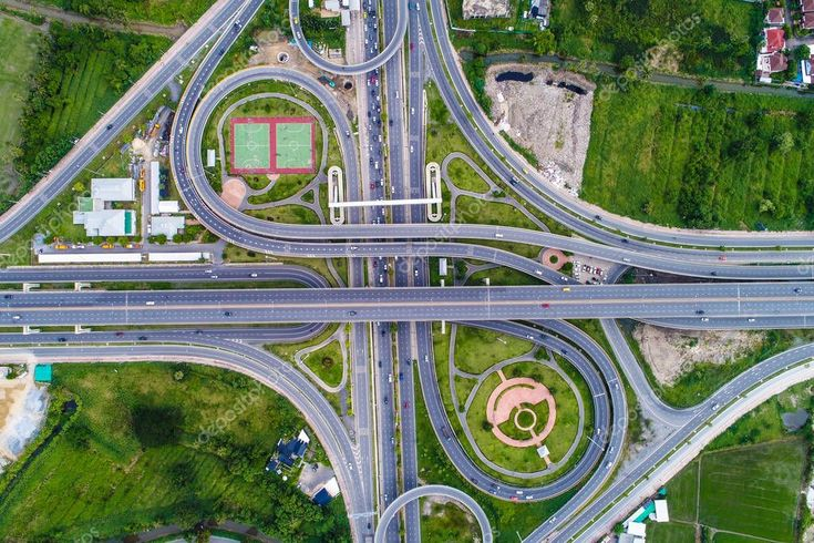 Aerial view transport junction road with satadium green