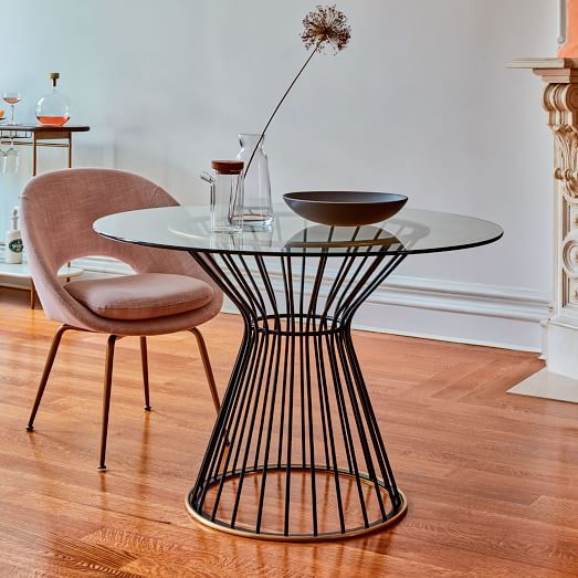 With its airy, metal base dressed up in a two-tone brass finish, our Hourglass Dining Table is high style for smaller spaces | shop now at west elm