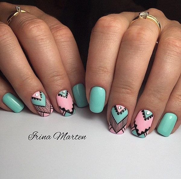 Pastel Blue and Pink Studded Geometric Nail Art. Get you nails painted with this extremely simple yet gorgeous pastel colored geometric nail art design. The effect of diamonds is a plus for this nail art.