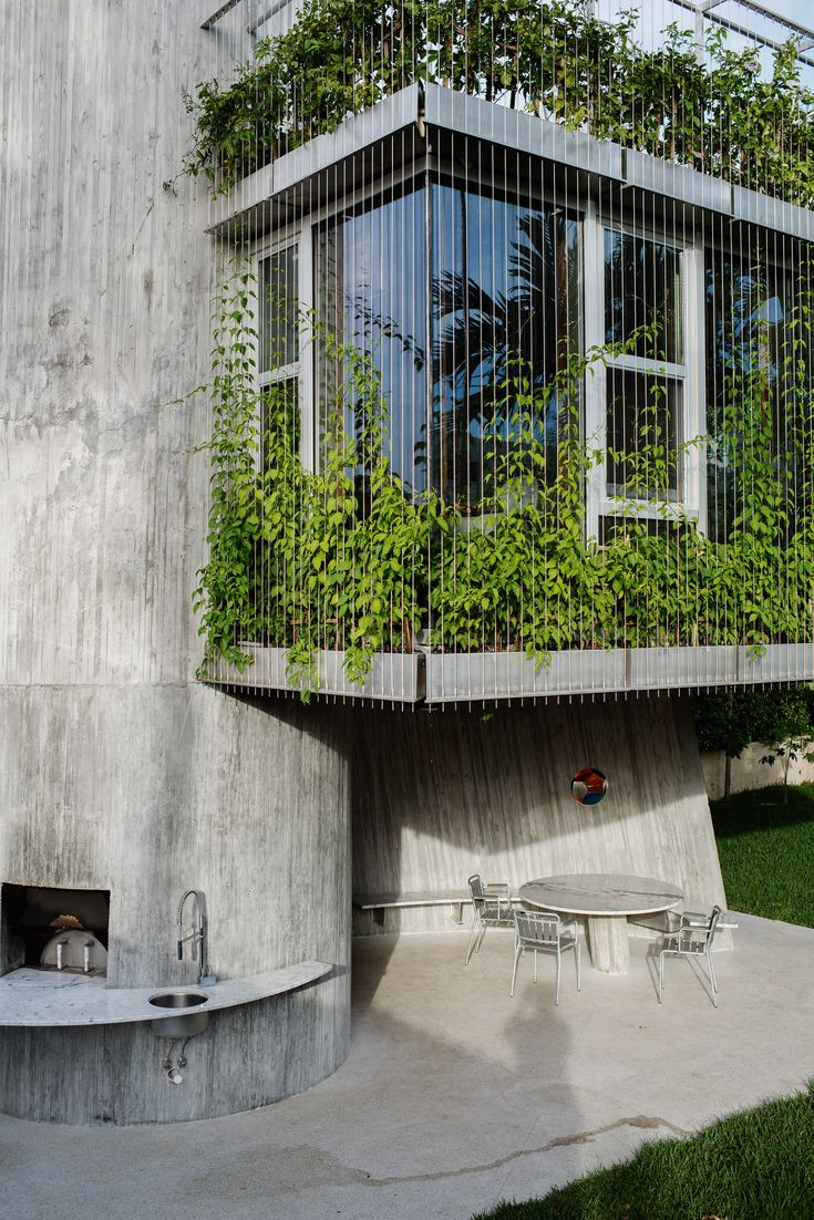 This plant-covered extension to a bungalow in Miami is supported by a spiral concrete core that was precisely calibrated to match the sun's path at the height of summer.