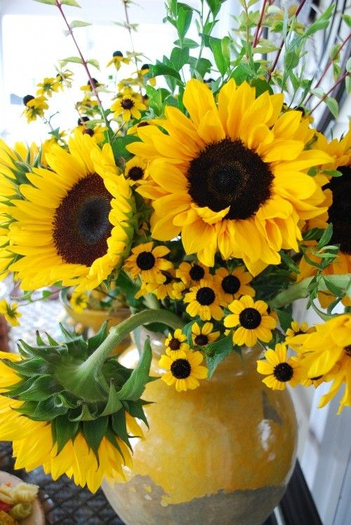 Sunflowers in a vase paired with similar colored flowers ~ Black-eyed Susans, Gerber and African Daisies and Coreopsis are all yellow with dark brown or black centers.