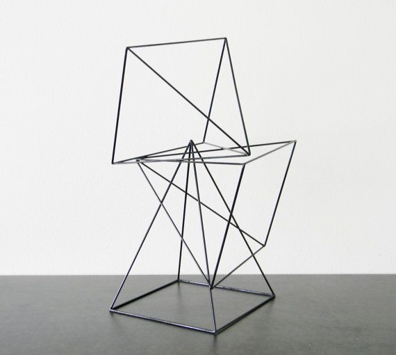 These handmade metal sculptures are as fun to play with as they are to look at. This set includes the three open frame pyramids that you see here