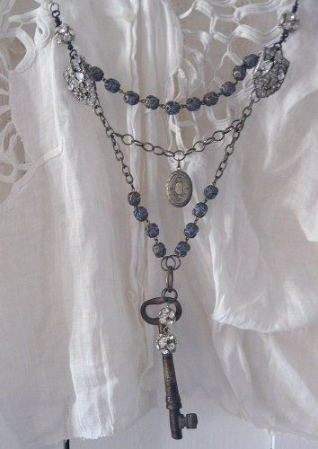 "This necklace ""Opening Doors"" is both delicate and meaningful with an embellished key to ..."