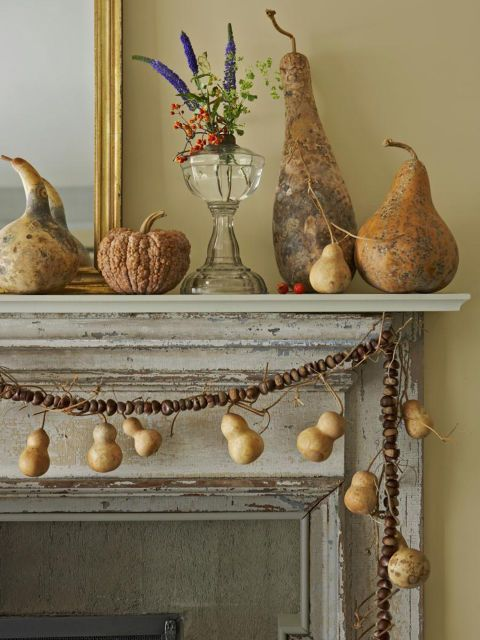 Dried gourds and squash form a still life on this mantel. Additional 'Tinyâ?¦