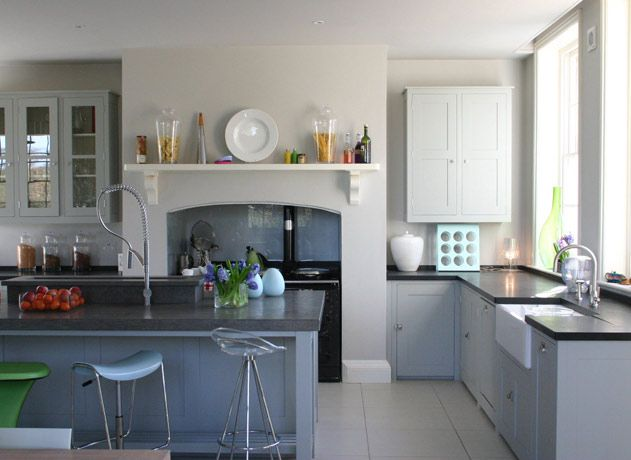 dual colour kitchen with white floor and grey worktops