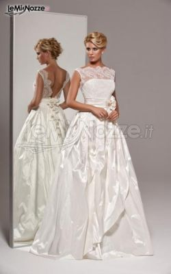 http://www.lemienozze.it/gallerie/foto-abiti-da-sposa/img41098.html Elegante abito da sposa con ricami e gonna voluminosa