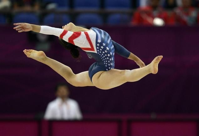 Aly Raisman, the U.S. gymnastics team captain, grabbed gold Tuesday in the Floor Exercise final and bronze on the Balance Beam.